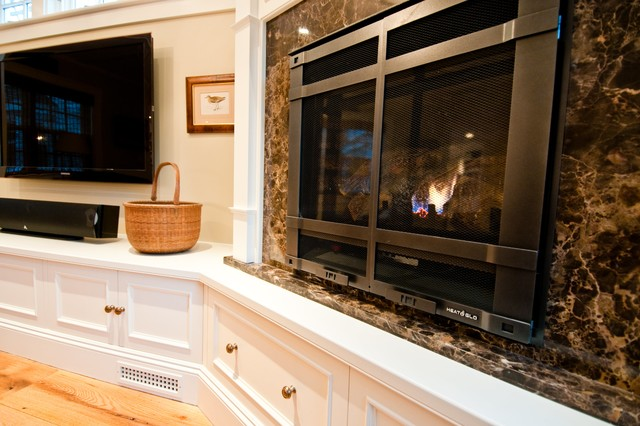 Inspiration for a large beach style open concept medium tone wood floor and brown floor family room remodel in Boston with beige walls, a standard fireplace, a stone fireplace and a wall-mounted tv