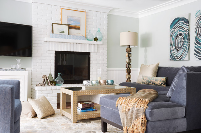 Family room - beach style family room idea in Los Angeles with gray walls, a standard fireplace, a brick fireplace and a wall-mounted tv