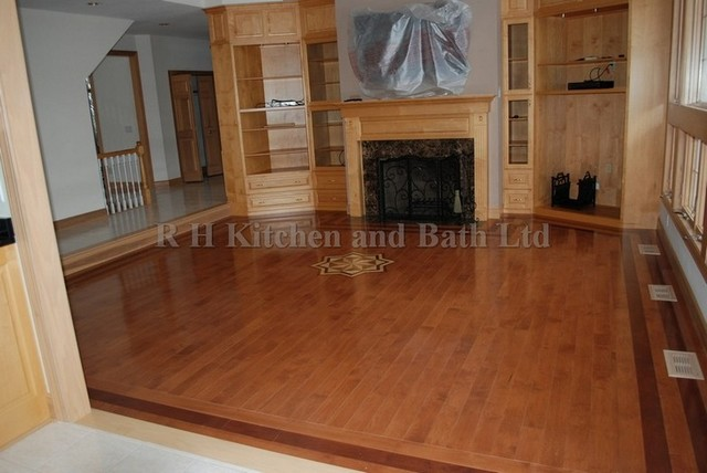 Maple hardwood floor in family room with a medallion and a for Hardwood floor designs borders