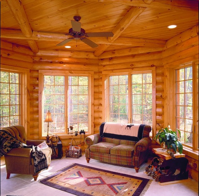 Maplecreek rustic family room other metro by for Log home sunrooms