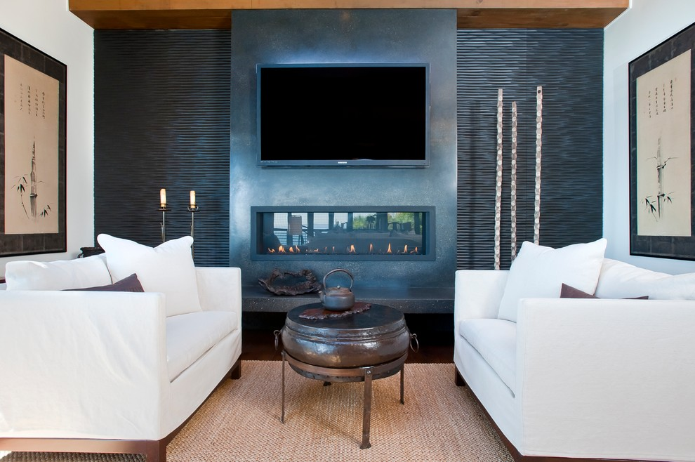 Family room - zen dark wood floor family room idea in San Francisco with white walls, a ribbon fireplace and a wall-mounted tv