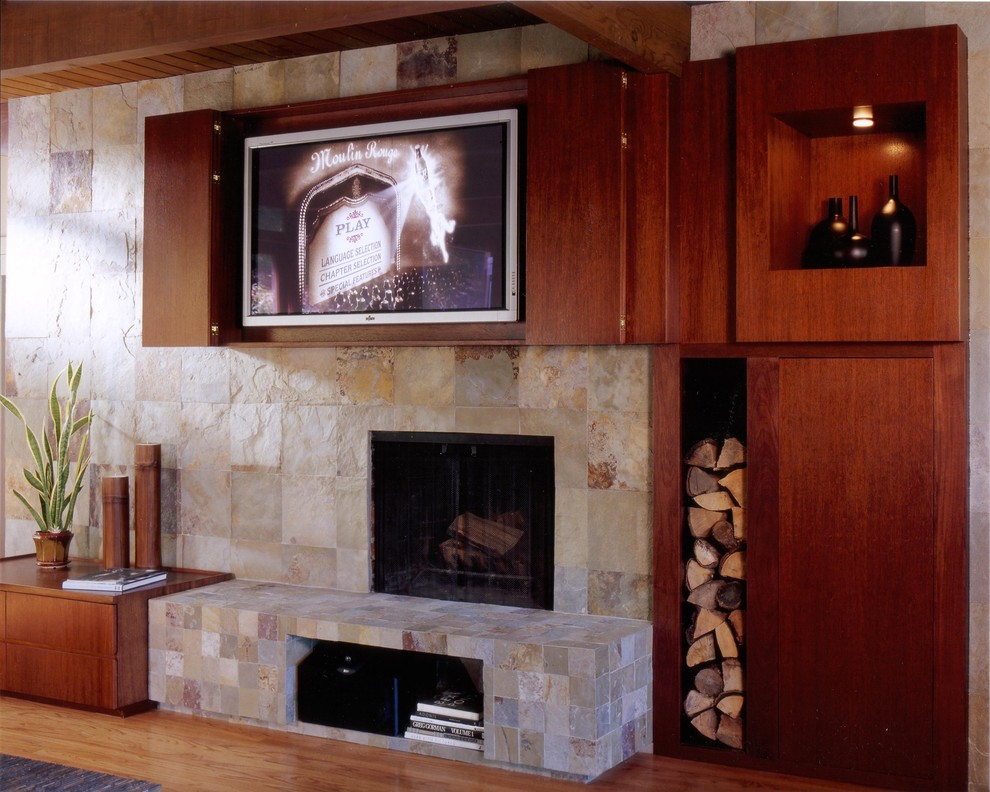 Inspiration for a modern light wood floor family room remodel in San Francisco with a stone fireplace, a media wall and a standard fireplace