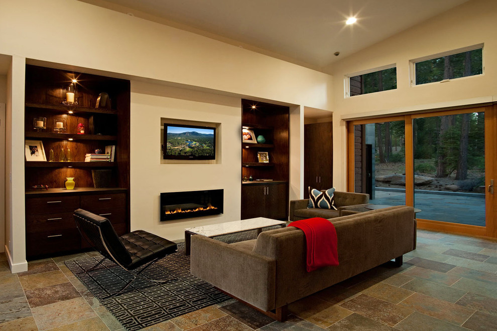 Trendy family room photo in Sacramento with beige walls, a ribbon fireplace and a wall-mounted tv