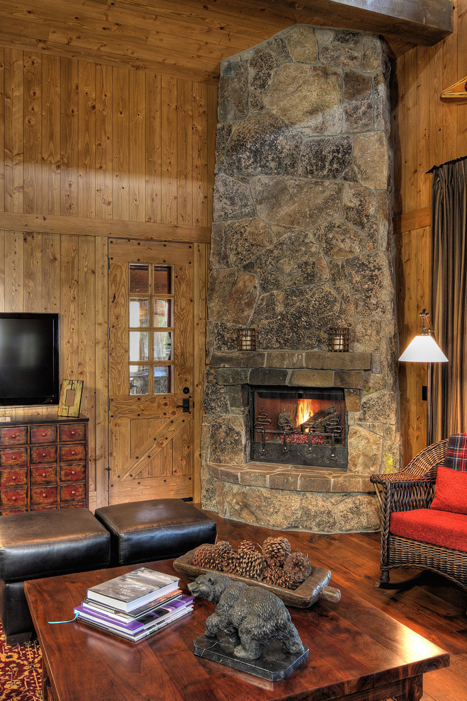 Example of a mountain style family room design in Phoenix with a corner fireplace and a stone fireplace
