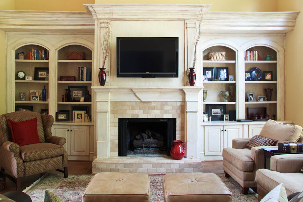 Elegant family room photo in Atlanta with a stone fireplace