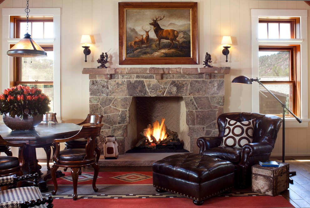 Mountain style family room photo in Denver with a stone fireplace
