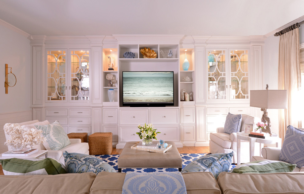 Inspiration for a timeless family room remodel in Dallas with a media wall