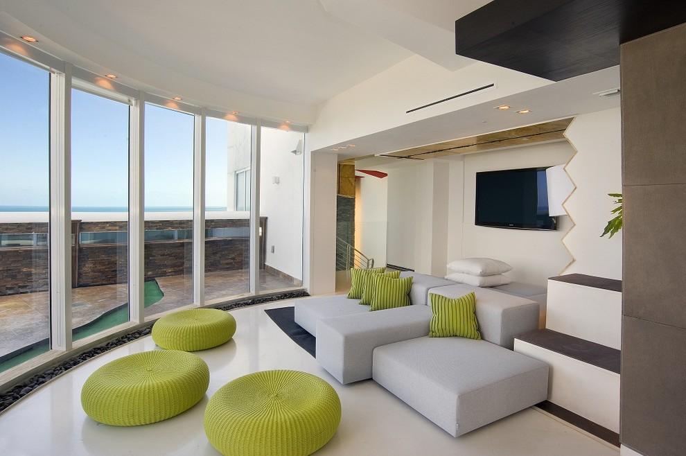 Family room - contemporary white floor family room idea in Miami
