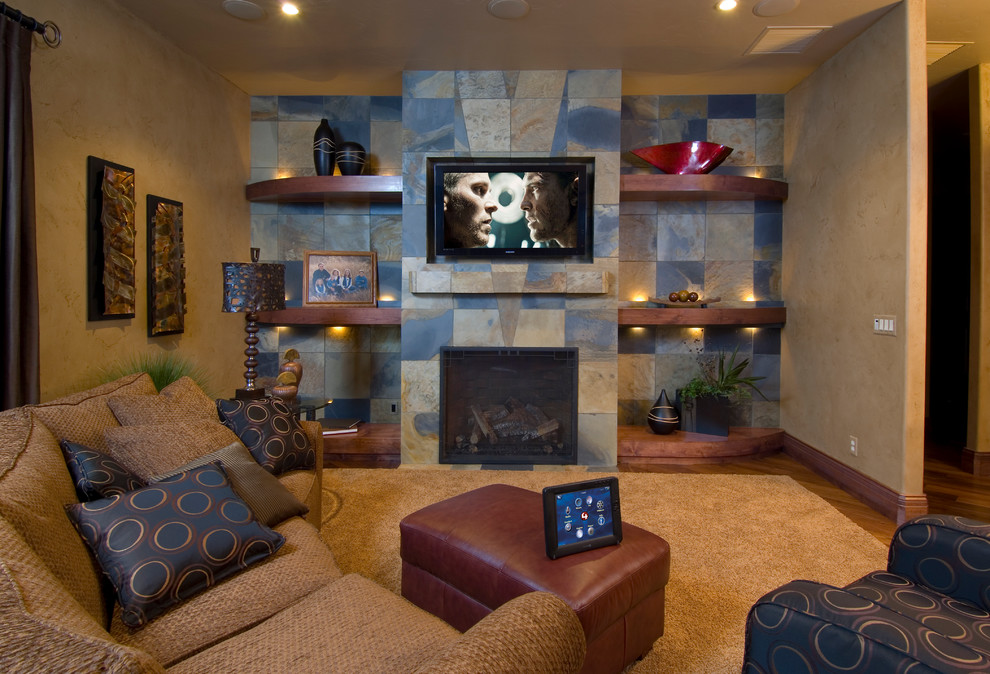 Family room - traditional family room idea in Denver with a tile fireplace
