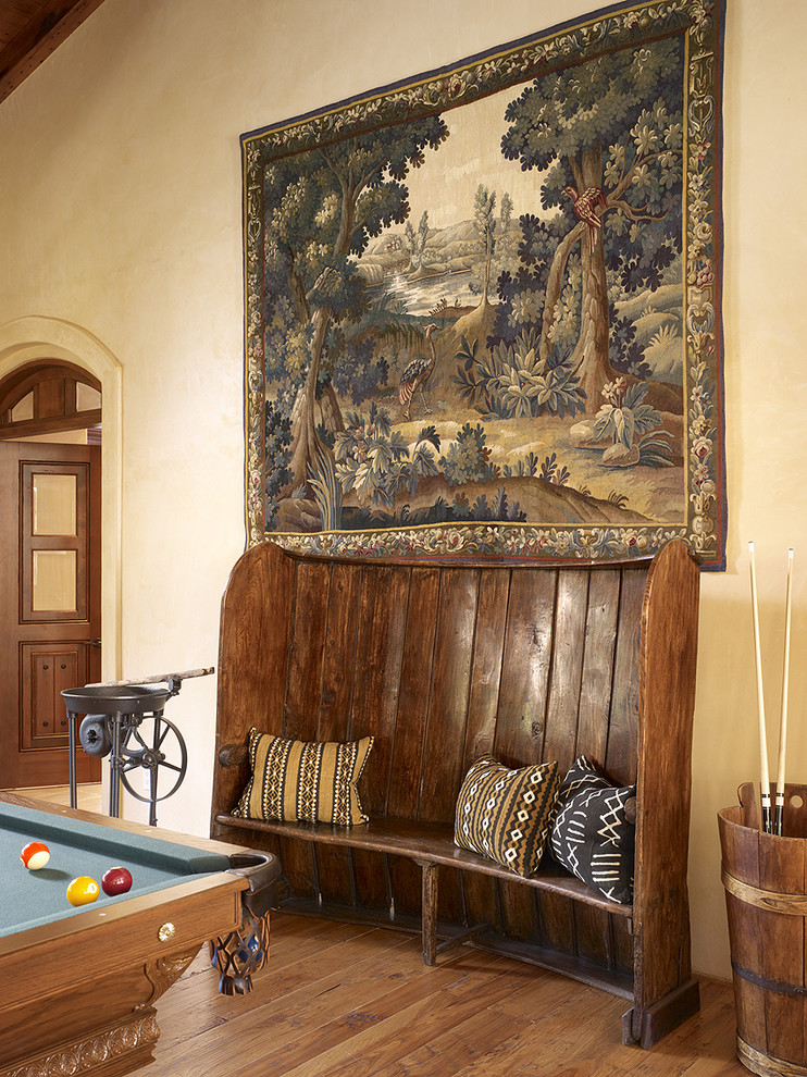 Inspiration for a mediterranean medium tone wood floor game room remodel in San Francisco with beige walls