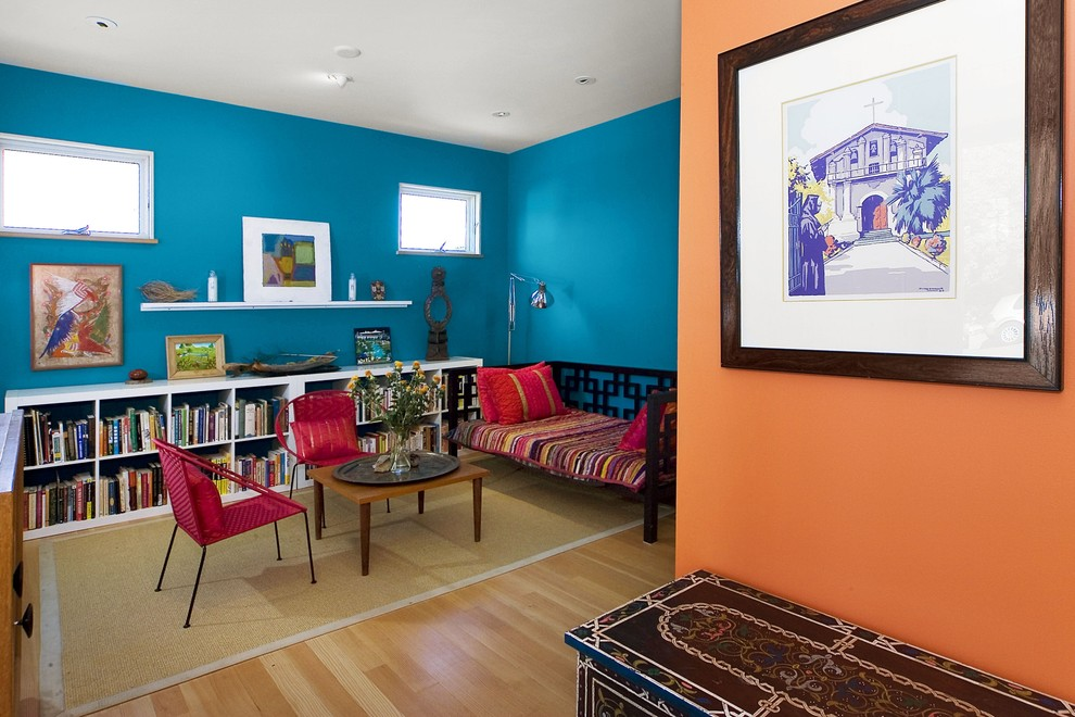Family room - contemporary medium tone wood floor and beige floor family room idea in San Francisco with blue walls