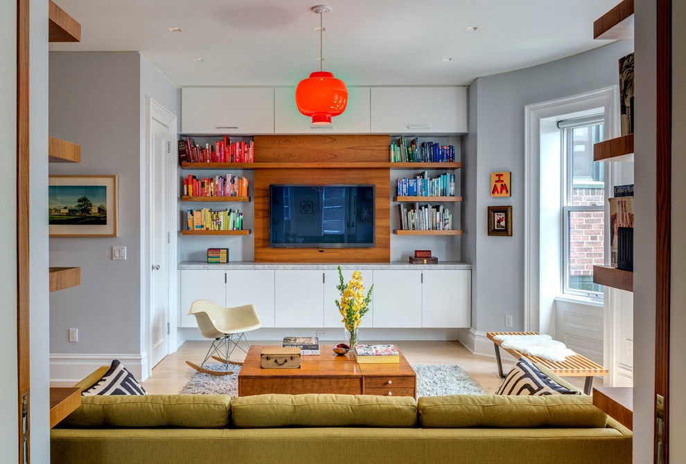 Example of a mid-sized 1960s enclosed light wood floor family room library design in Other with gray walls, no fireplace and a wall-mounted tv