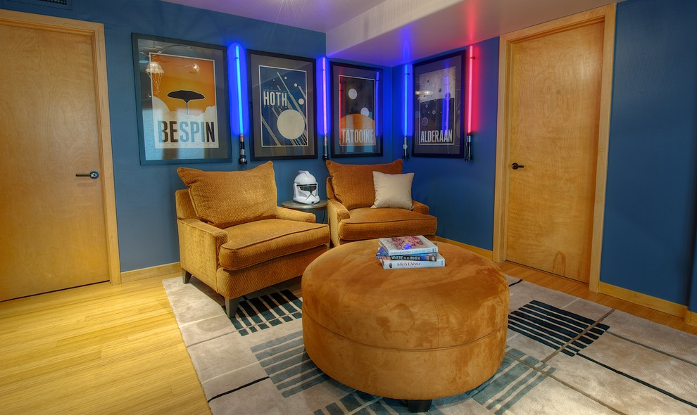 Inspiration for a contemporary enclosed family room remodel in Phoenix with blue walls