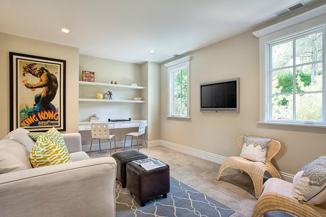 Example of a classic family room design in San Francisco with beige walls and a wall-mounted tv