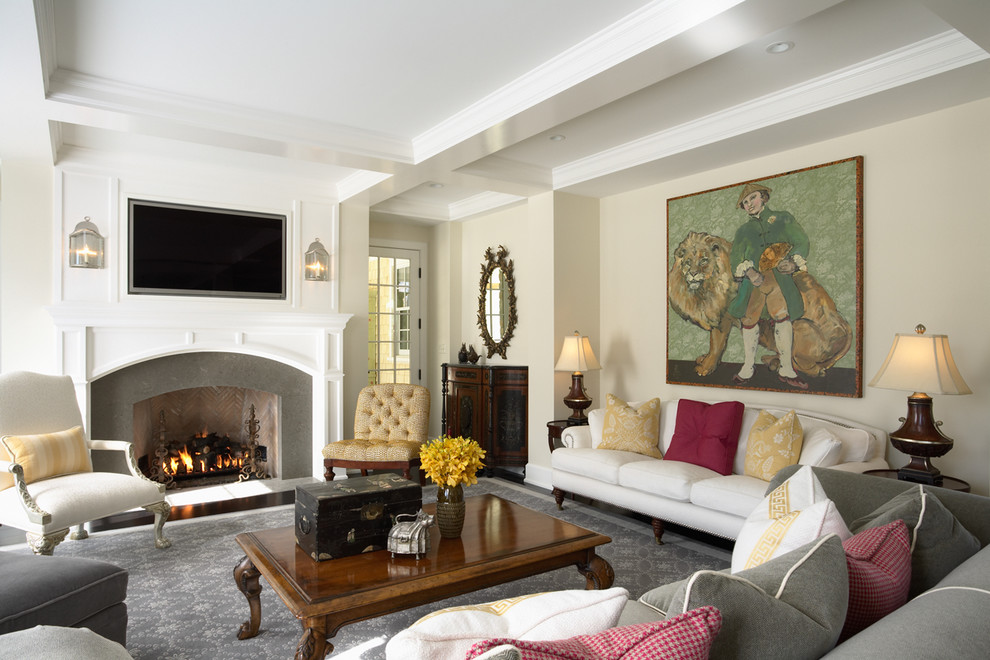 Inspiration for a timeless family room remodel in Minneapolis with beige walls, a standard fireplace and a wall-mounted tv