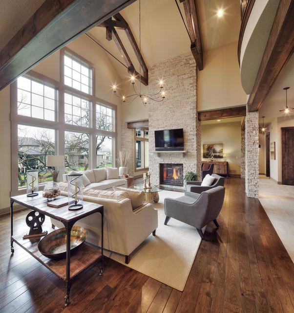 Model home starr homes llc rustic family room for Model home flooring