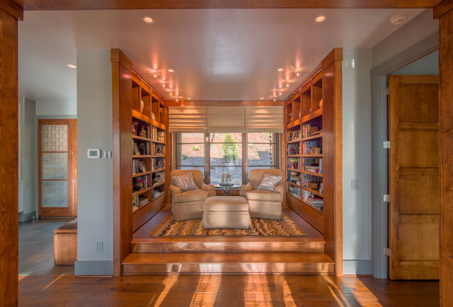 Example of a small transitional open concept medium tone wood floor family  room design in Other