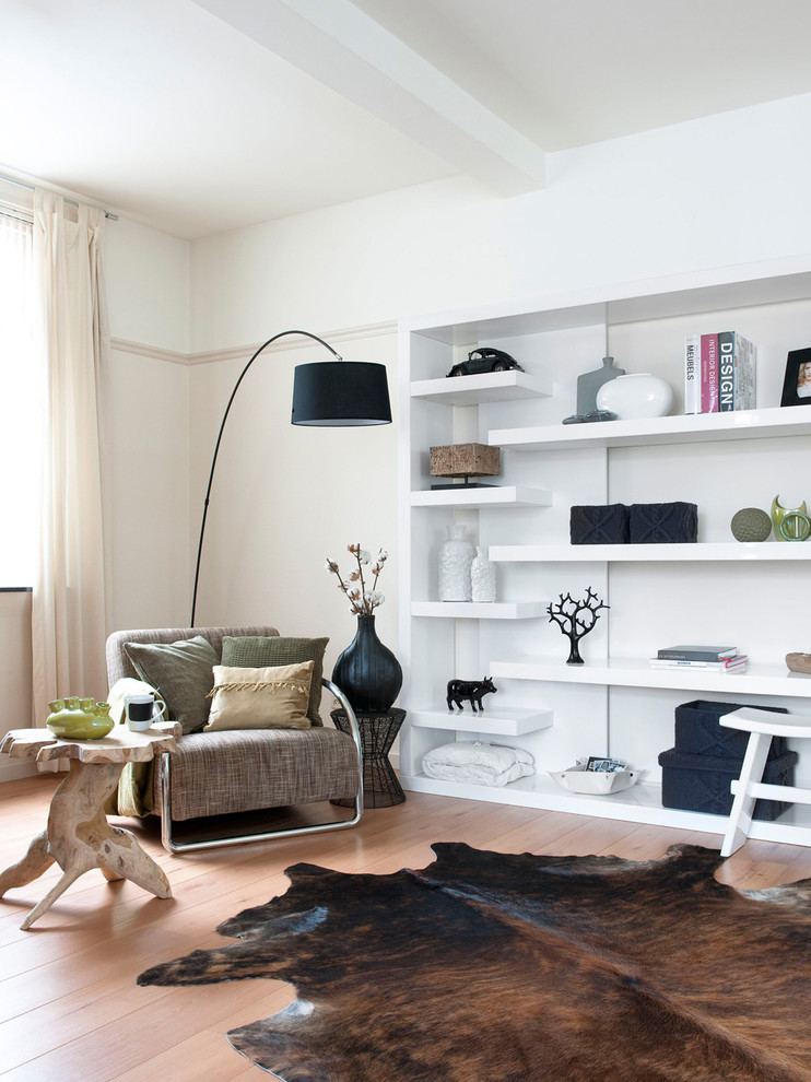 Example of a trendy medium tone wood floor family room design in Amsterdam with beige walls