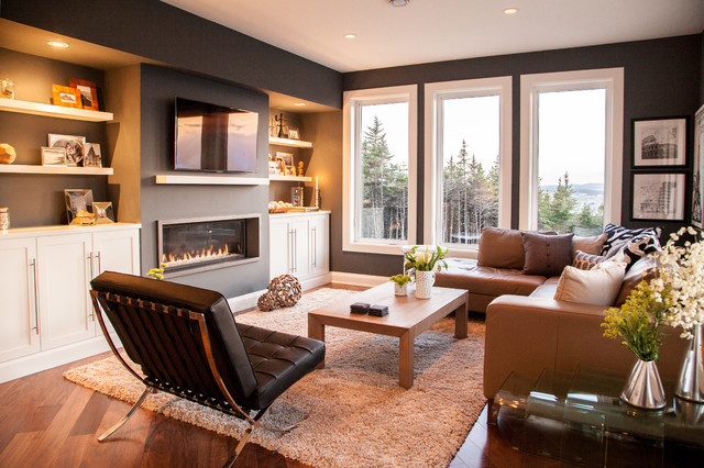 modern family living room design. Example of a trendy medium tone wood floor family room design in Other with  black walls Modern Family Room Houzz