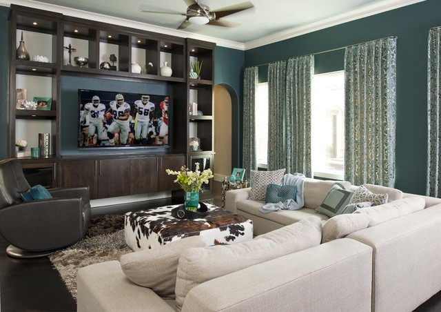 example of a trendy family room design in dallas with blue walls and a media wall