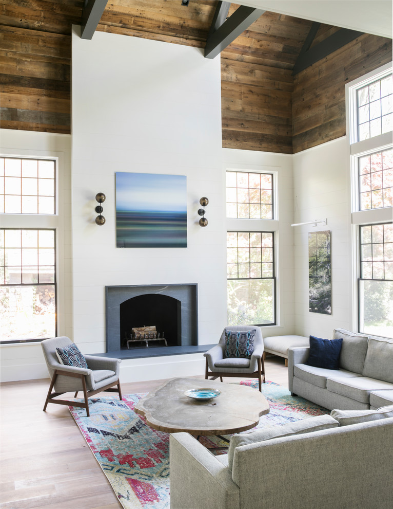Farmhouse open concept light wood floor and beige floor family room photo in New York with white walls and a standard fireplace