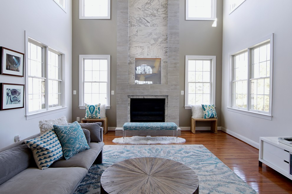 Example of a beach style family room design in DC Metro with gray walls, a standard fireplace and a tile fireplace