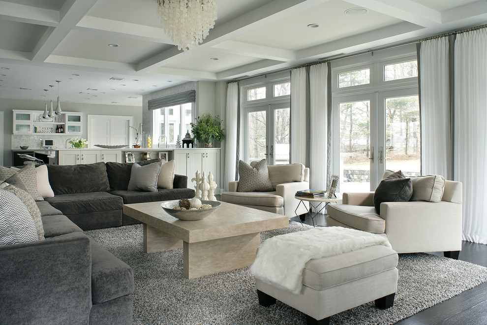 Inspiration for a contemporary open concept dark wood floor family room remodel in New York with gray walls