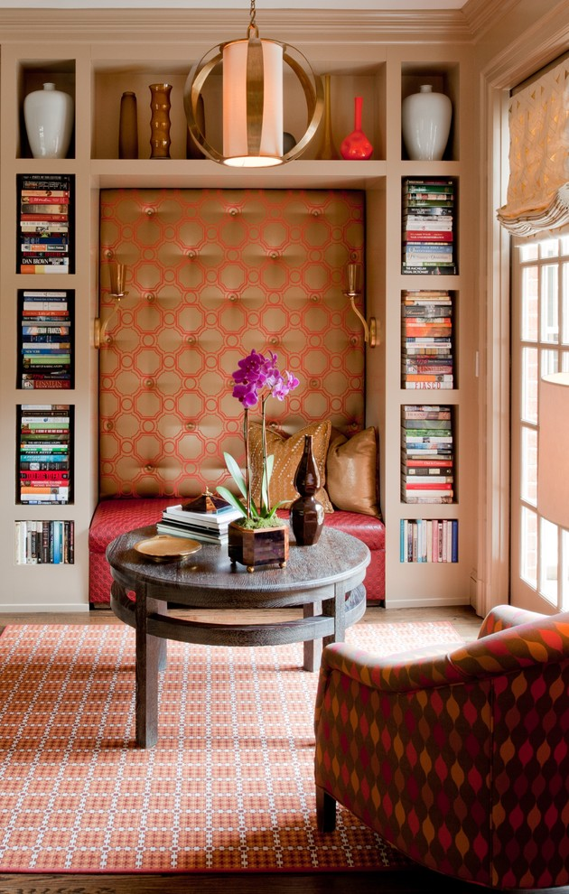 Inspiration for a transitional family room library remodel in Charlotte with beige walls