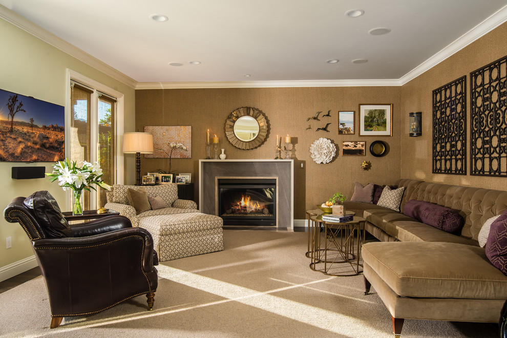 Inspiration for a mid-sized timeless enclosed dark wood floor family room remodel in San Francisco with a standard fireplace, a stone fireplace, a wall-mounted tv and brown walls