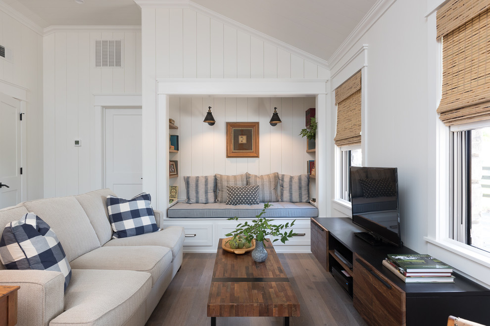 Inspiration for a mid-sized cottage open concept medium tone wood floor and brown floor family room remodel in Other with white walls, no fireplace and a tv stand