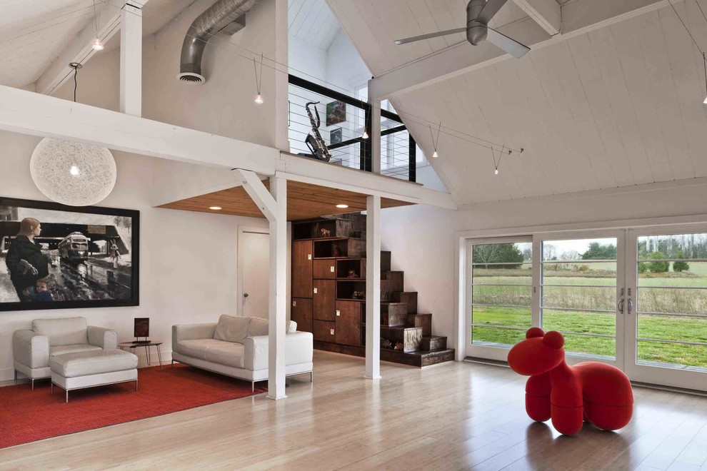 Inspiration for a country light wood floor family room remodel in Philadelphia with white walls
