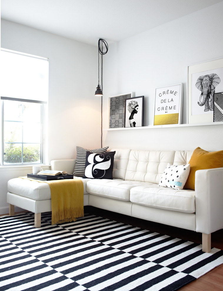 Family room - scandinavian carpeted family room idea in San Francisco with white walls
