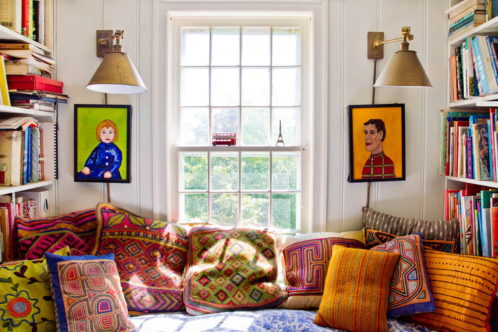 Example of a country family room design in New York