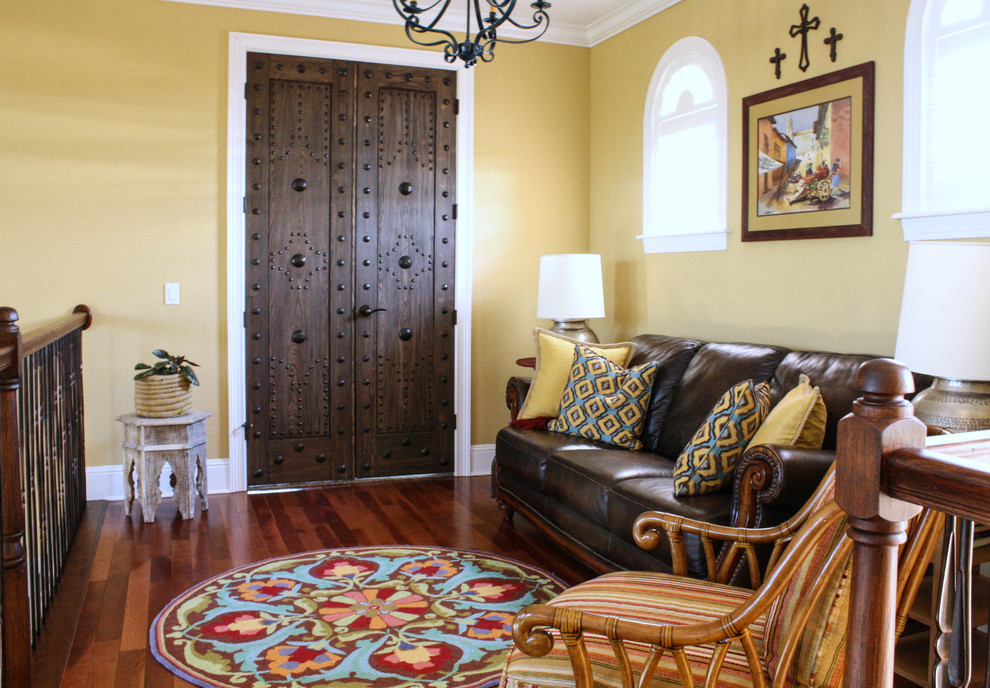 Tuscan family room photo in Tampa with yellow walls