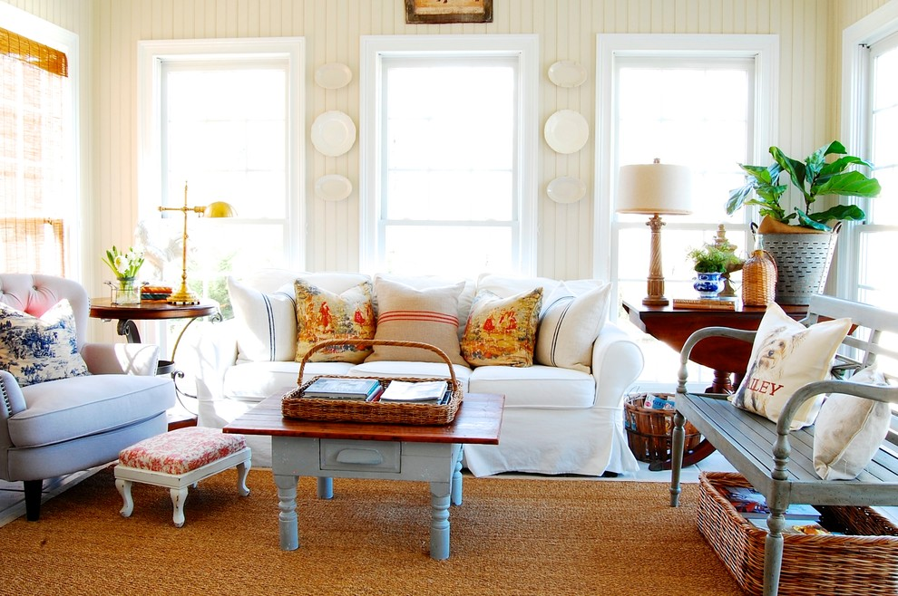 Example of a cottage chic family room design in New York with beige walls