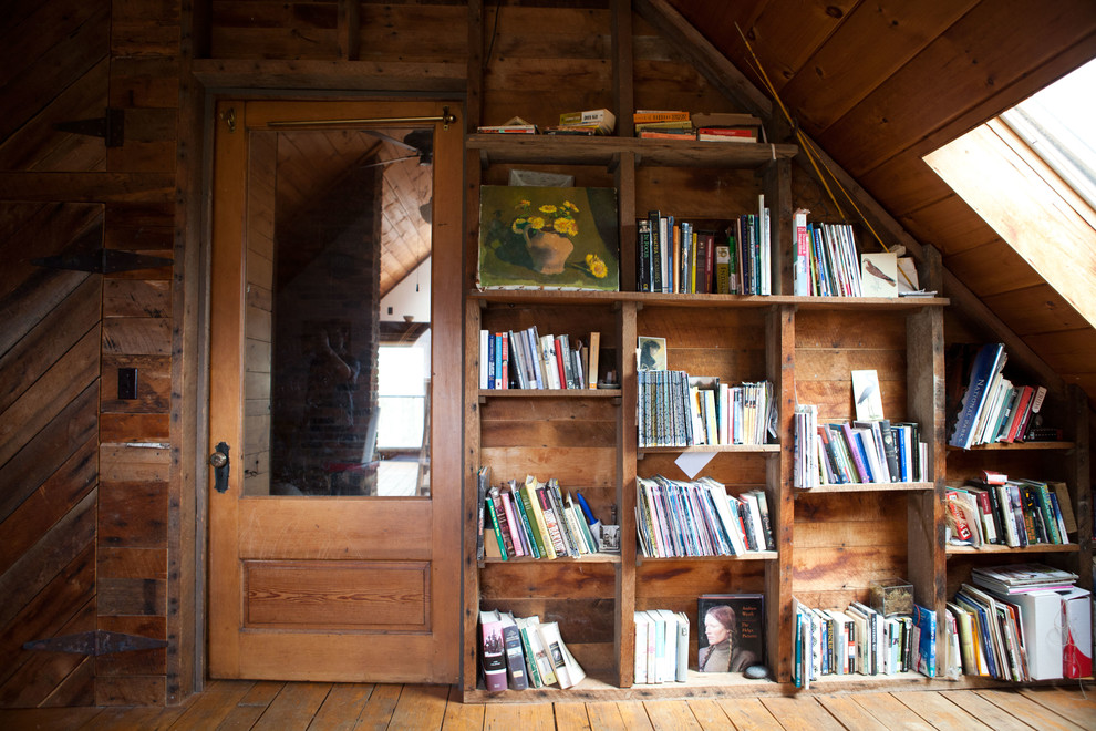Cottage enclosed medium tone wood floor family room library photo in Burlington with brown walls