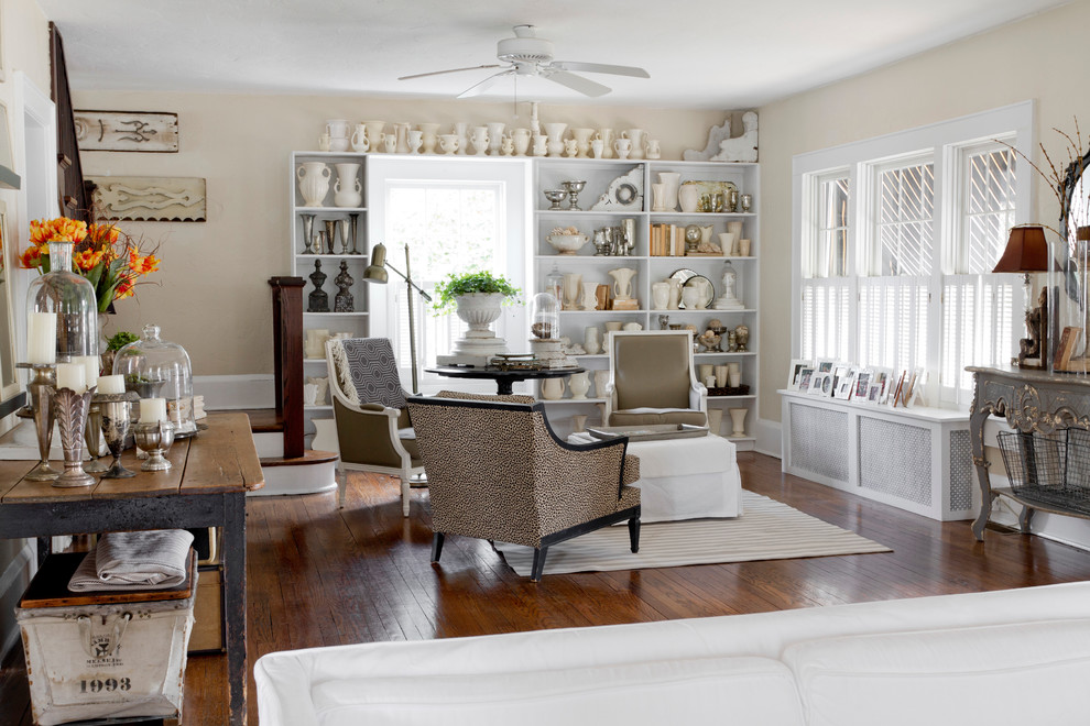 Inspiration for a shabby-chic style medium tone wood floor family room remodel in New York with beige walls