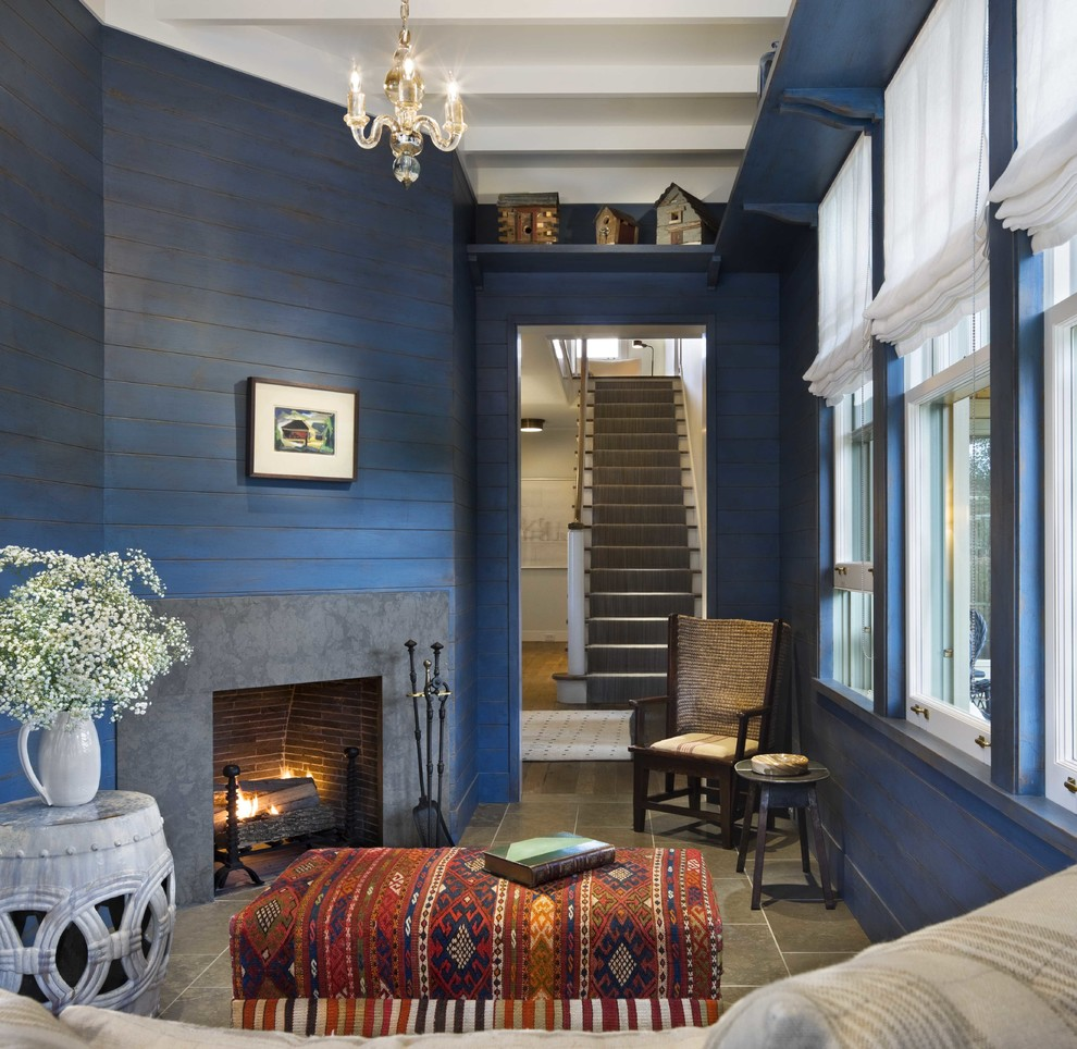 Small beach style enclosed porcelain tile and gray floor family room photo in Boston with blue walls, a corner fireplace and a concrete fireplace
