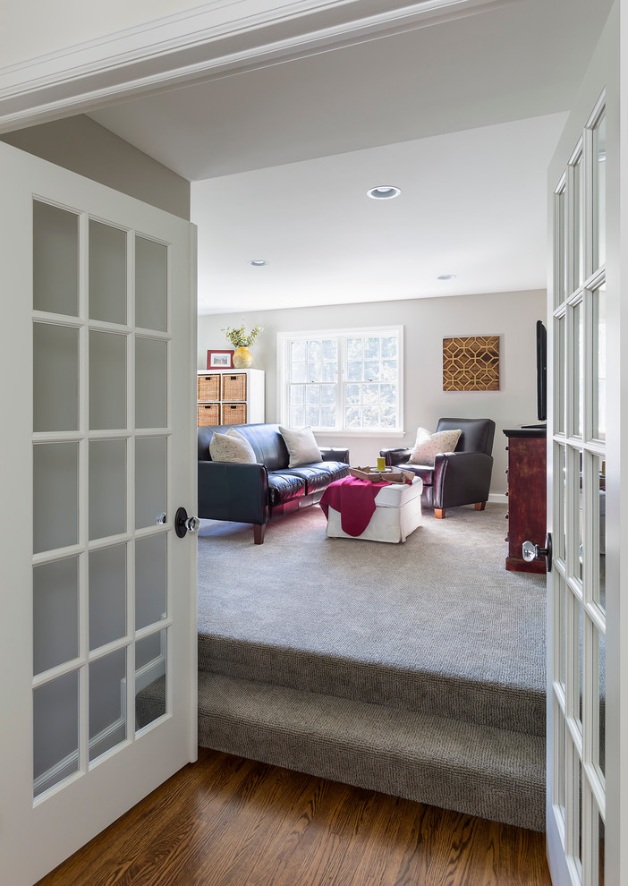 Mid-sized transitional enclosed carpeted family room photo in Minneapolis with white walls, no fireplace and a tv stand