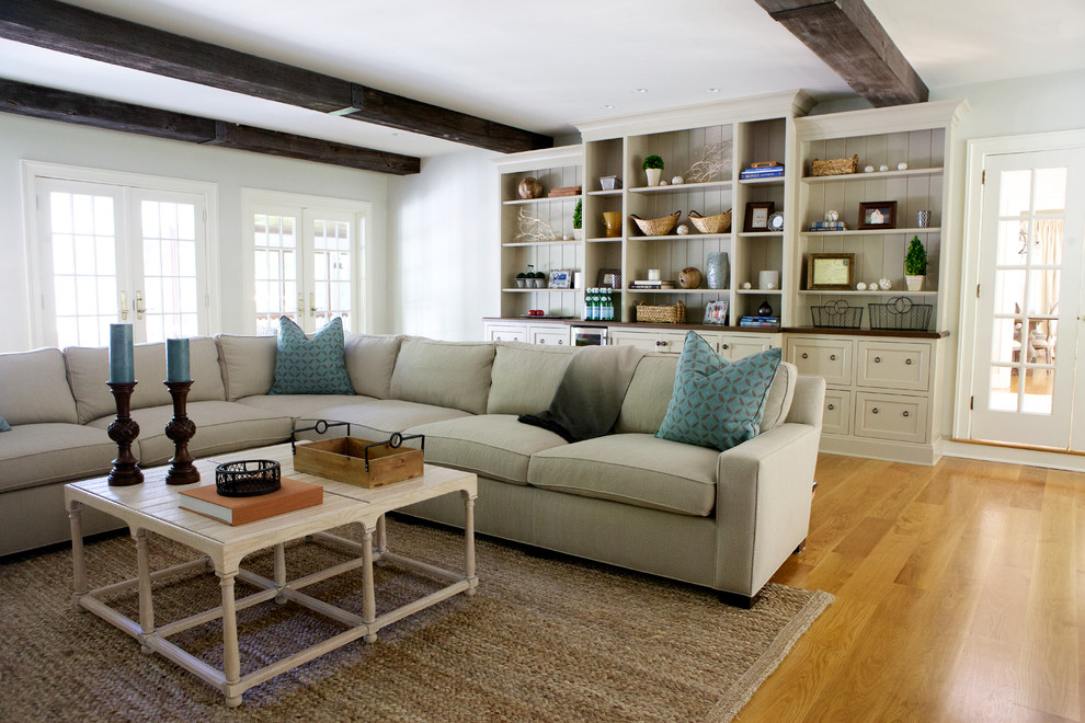 Family room - transitional medium tone wood floor family room idea in Boston with white walls