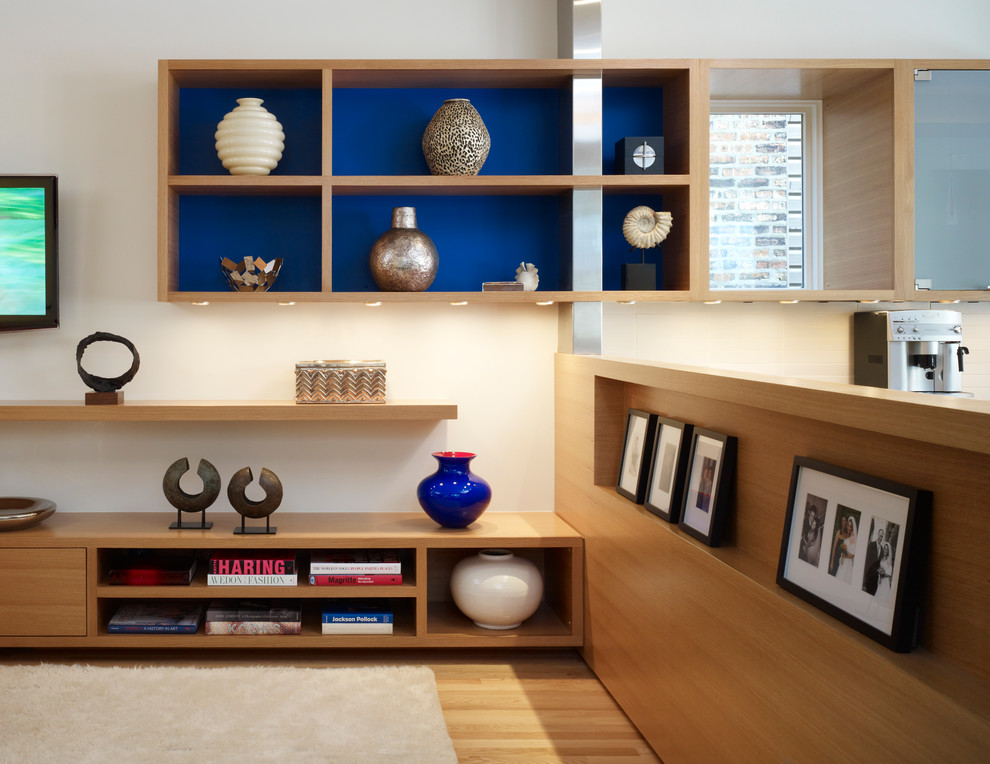 Family room - modern light wood floor family room idea in Chicago with beige walls