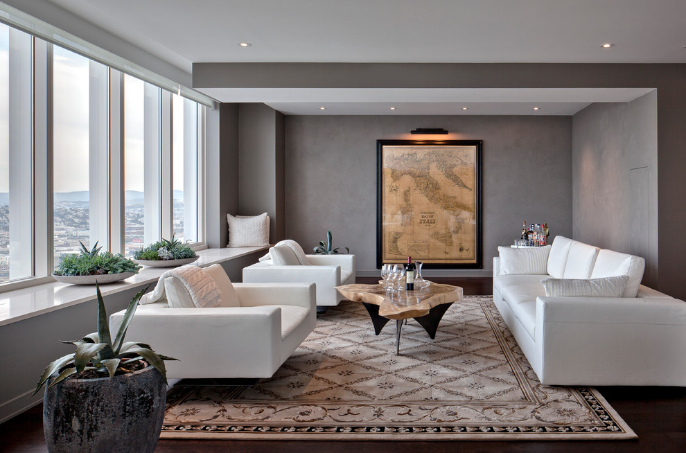 Trendy dark wood floor family room photo in San Francisco with gray walls
