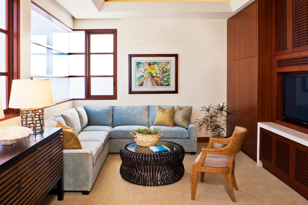 Example of a trendy carpeted family room design in Orange County with beige walls and a media wall