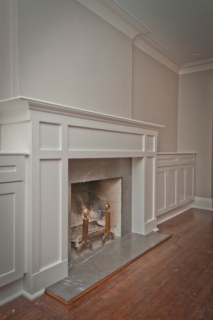 Family room Craftsman style  fireplace mantle with granite hearth and surround and with built-in storage cabinets on both sides. MDF