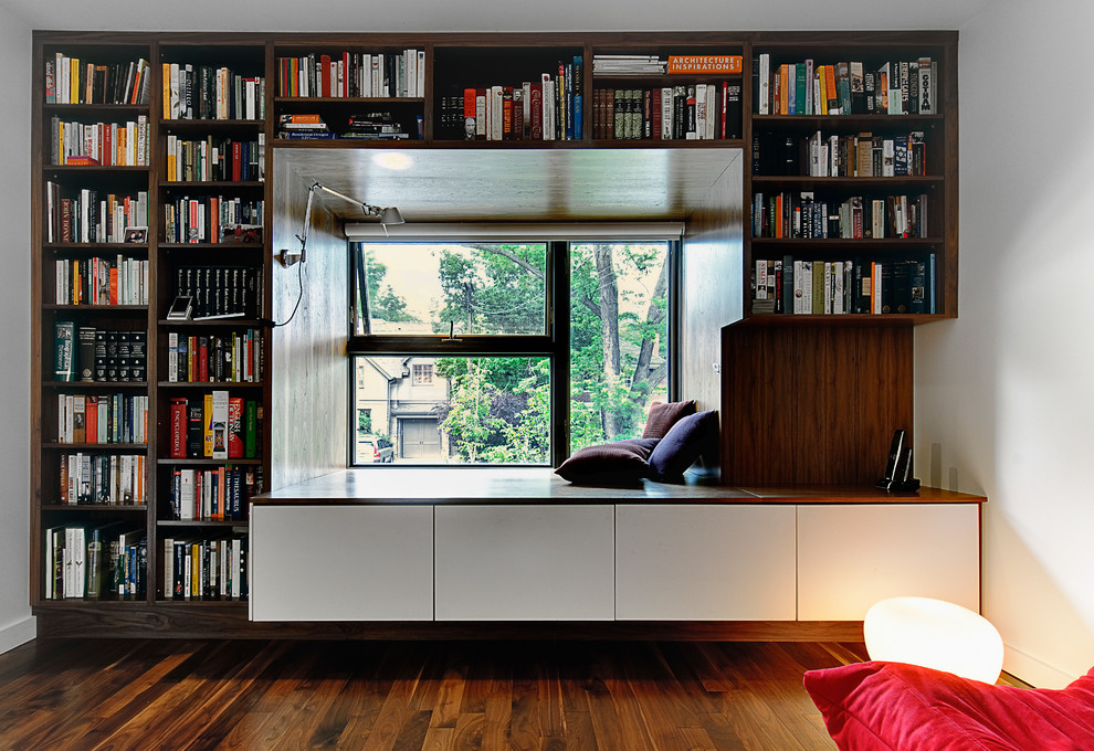Family room library - mid-sized contemporary enclosed medium tone wood floor family room library idea in Toronto with white walls, no fireplace and no tv