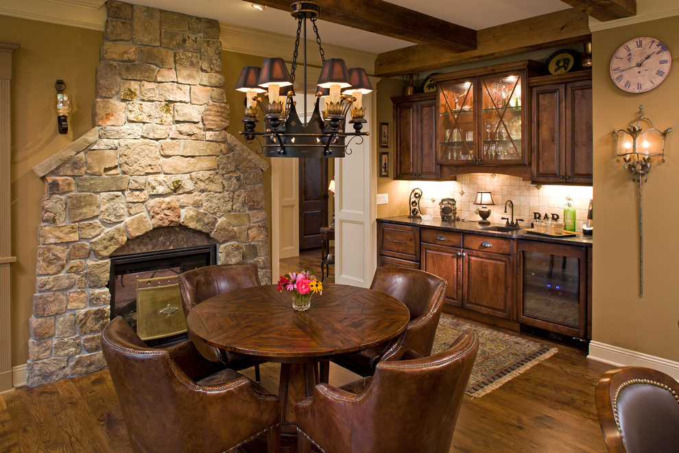 Inspiration for a large timeless open concept medium tone wood floor family room remodel in Minneapolis with a two-sided fireplace and a stone fireplace