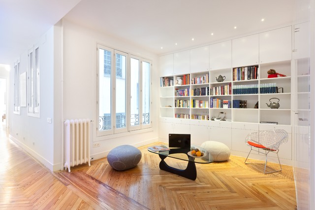 Small trendy open concept medium tone wood floor family room photo in Madrid with white walls, no fireplace and no tv