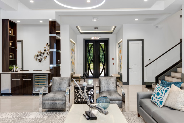 Example of a large minimalist open concept porcelain floor family room design in Orlando with a bar, white walls, no fireplace and a wall-mounted tv