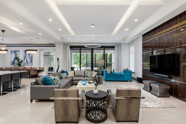 Large minimalist open concept porcelain floor family room photo in Orlando with white walls, no fireplace and a wall-mounted tv