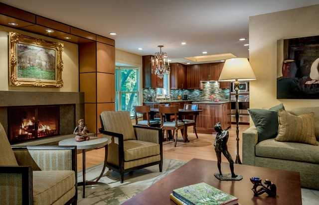 Inspiration for a timeless open concept medium tone wood floor family room remodel in Chicago with beige walls and a standard fireplace